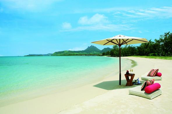 Beach relaxation at Anahita Beach Resort. Mauritius