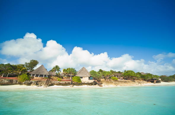 Ras Nungwi Beach Hotel rests on the beautiful shores of Zanzibar.